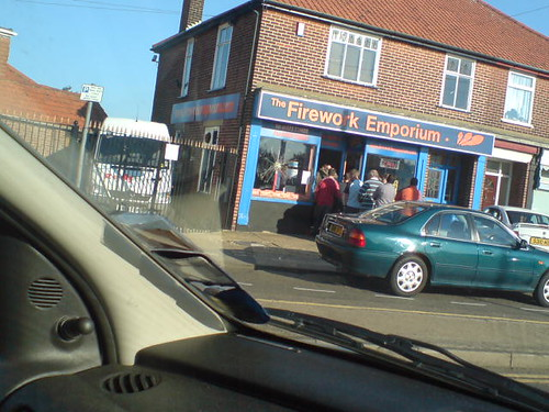 Queue of people outside firework shop