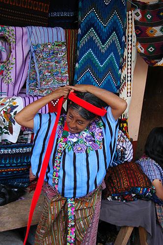 Lago Atitlan Santiago - 12 Woman donning tocoyal