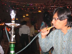 me blowing a hooka at Village (by kapsi)