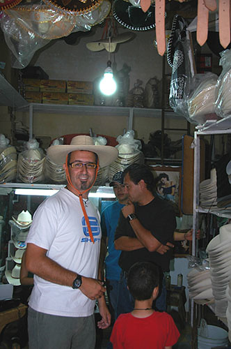 Acambaro - 11 Eitan trying a traditional michoacan straw hat
