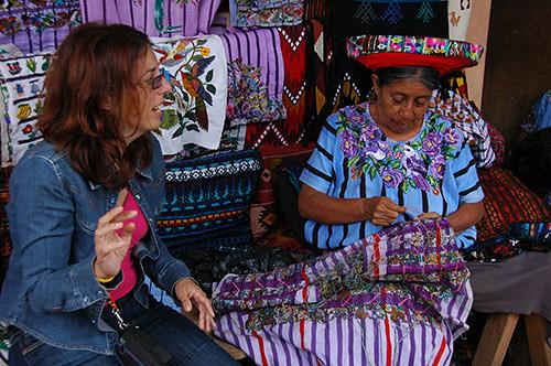 Lago Atitlan Santiago - 16 Woman adding Embroidery