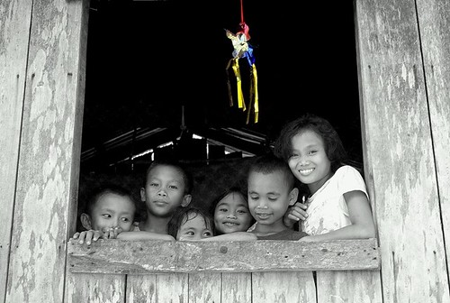 Image of a Filipino rural family by the window
