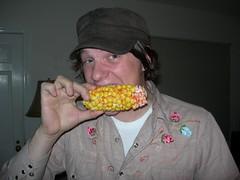 Adam chomps down on candy corn on the cob
