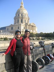 Lydia and Grant strike a pose with Segways nearby and Musée des Invalides in the background.
