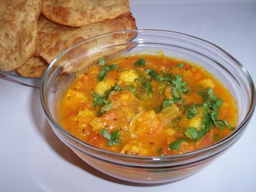 Alu Bhaaji served with warm, crispy Puris