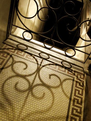 Spiral shadows on the tiles