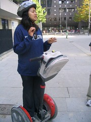 Michelle holds her Segway still (with no hands, the show-off) as she reviews important safety points.