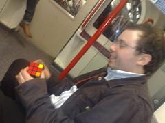 101120081097 Bloke On Tube Does Rubik's Cube