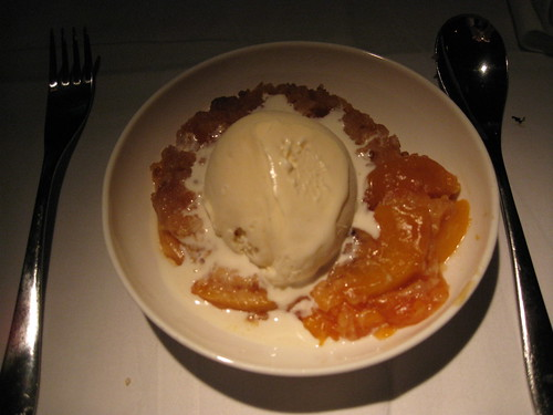 Warm peach crisp with vanilla ice cream