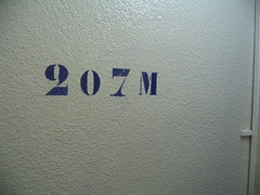 Picture of a sign in a stairwell noting a height of 207 meters