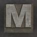 Caslon metal type letter M