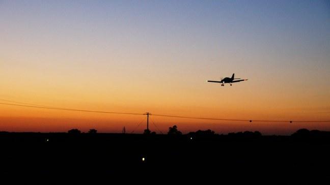 SportCruiser landing at Cushing Field (0C8) as sun sets