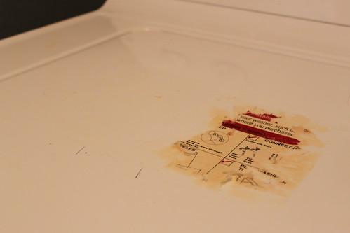Removing sticker from washing machine