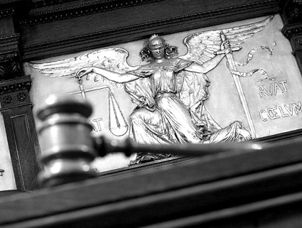 Gavel and figure of justice