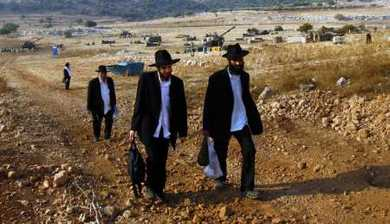 ultra-orthodox visit an artillery site, near Fassuta, Israel