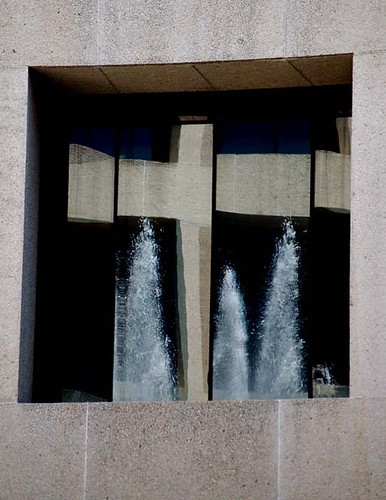 Fountain reflected in the Hirshorn Museum