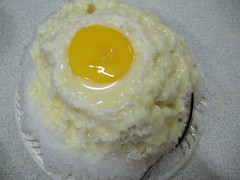 shaved ice dessert  with condensed milk and a raw egg