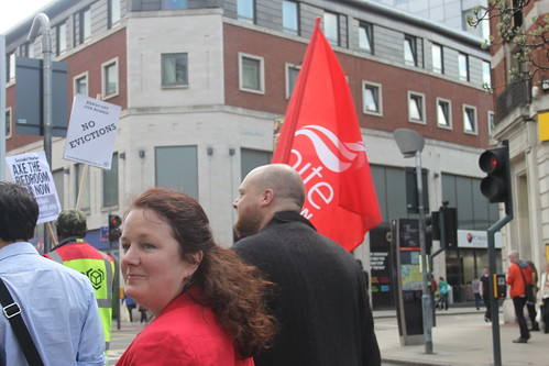 Karen Bruce walking behind the Unite banner at the Leeds against the bedroom tax rally