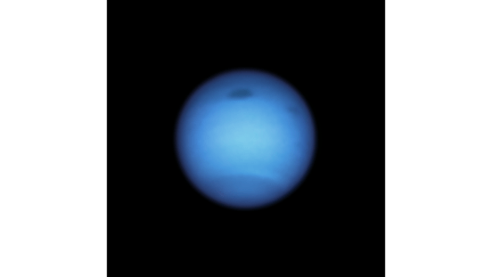Neptune's mysterious dark spot has changed direction and experts are confused