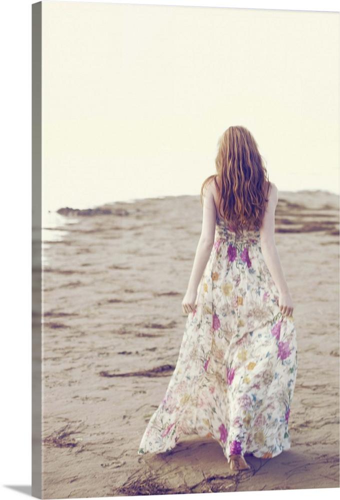 Young Woman In Long Summer Dress Walking Away On Beach