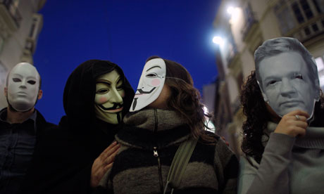 WikiLeaks Anonymous supporters wear masks during a demonstration in Malaga