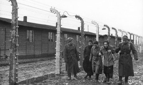 Soviet soldiers are seen with some of the prisoners they liberated in Auschwitz