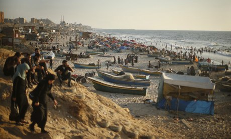 Palestinians enjoy the weather on the beach in Gaza City