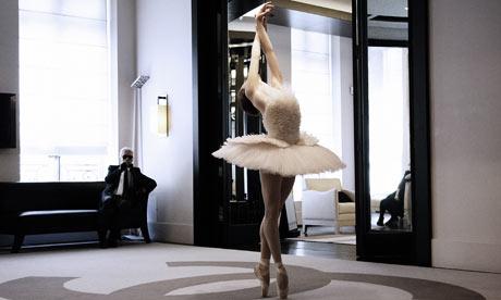 Karl Lagerfeld, creative director at Chanel, watches Elena Glurdjidze dance