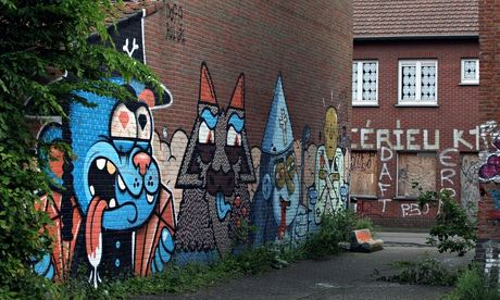 Writing on the wall? … creations by the street artists Resto and Bue in the Belgian village of Doel.