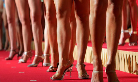 Miss University contestants prepare to take part in the swim suit round.