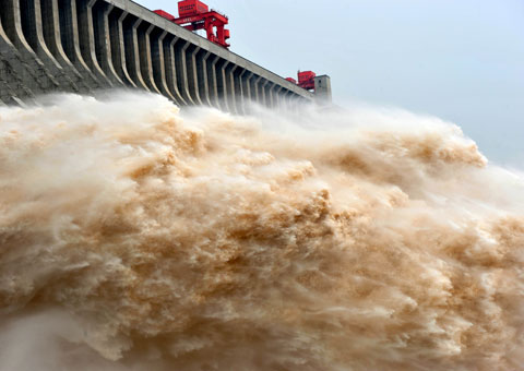 Floodwater is discharged through the Three Gorges Dam in central China's Hubei Province