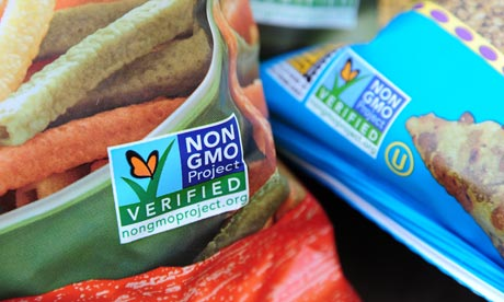 Labels on bags of snack foods indicate they are non-GMO