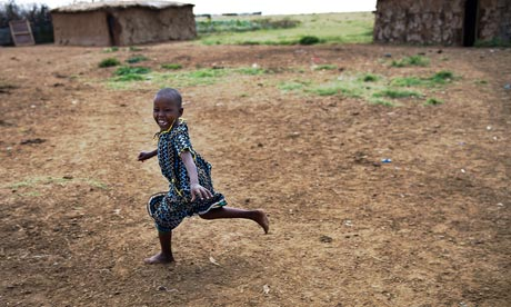 MDG : Development and wellbeing : Happy young Masai girl  in Kenya