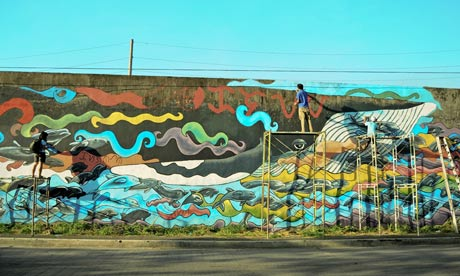 Mural painting of Dolphins Love Freedom led by AG Saño, Philippine