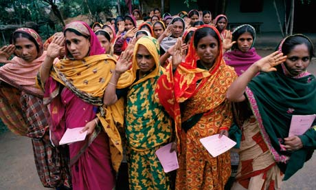 women repay microloans in Bangladesh