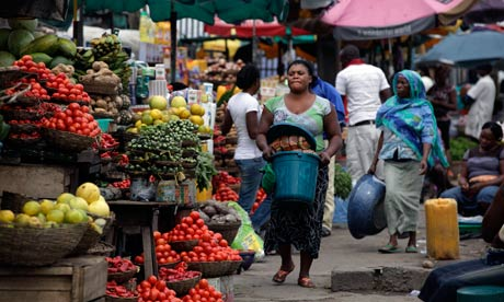 Women sell vegetables and other food in a market on World Food Day in Lagos, Nigeria