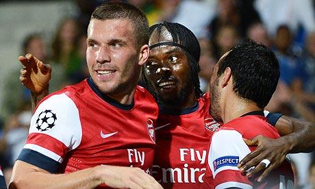 Hugs all round as Gervinho, centre, is congratulated by Lukas Podolski,