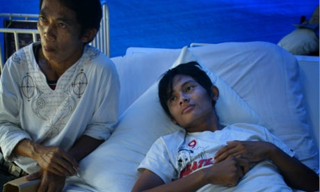 Ramlan, an eighteen year old construction worker who sawed off his own trapped right leg