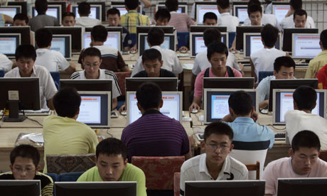Customers use computers at an internet cafe in Taiyuan, China
