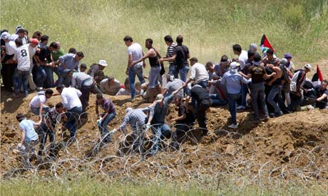 Syrian rioters try to cut border fence