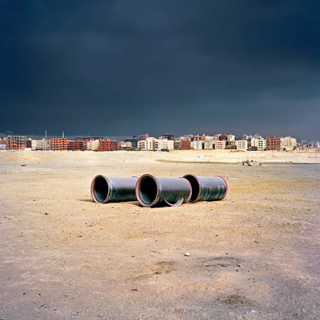 Sewage pipes waiting to be laid, New Cairo. Photograph: Jason Larkin/Panos Pictures via Guardian Website