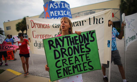 Medea Benjamin of Code Pink protests in August outside a building in Florida where the group says drones are built. Photograph: Joe Raedle/Getty Images