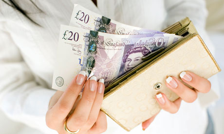 Woman takes £20 notes out of her purse