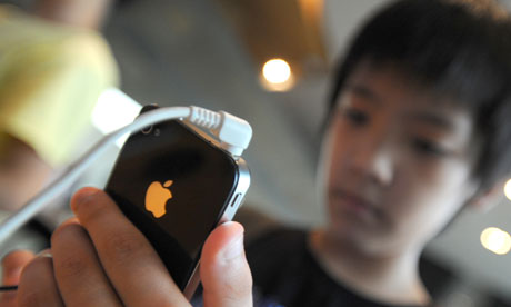 A South Korean boy uses an iPhone 4