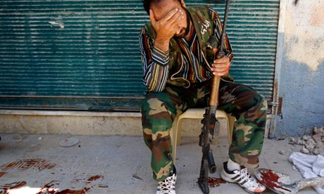 A Free Syrian Army fighter reacts after his friend was shot by the Syrian army, Aleppo, August 2012