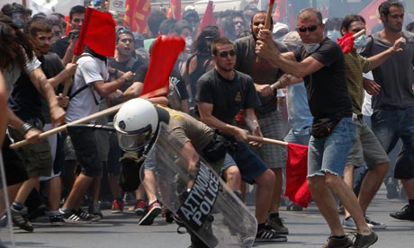 Greek rioters beat policeman