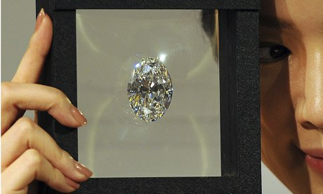 A model holds the flawless oval diamond