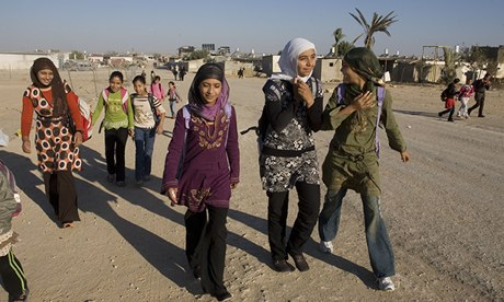 Bedouin children walk to school in the Negev desert