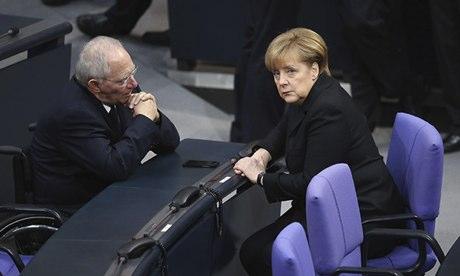 Angela Merkel, with Germany's finance minister Wolfgang Schaeuble