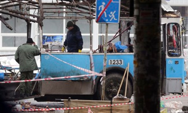 Forensic teams comb the remains of the trolleybus for evidence, in Volgograd.